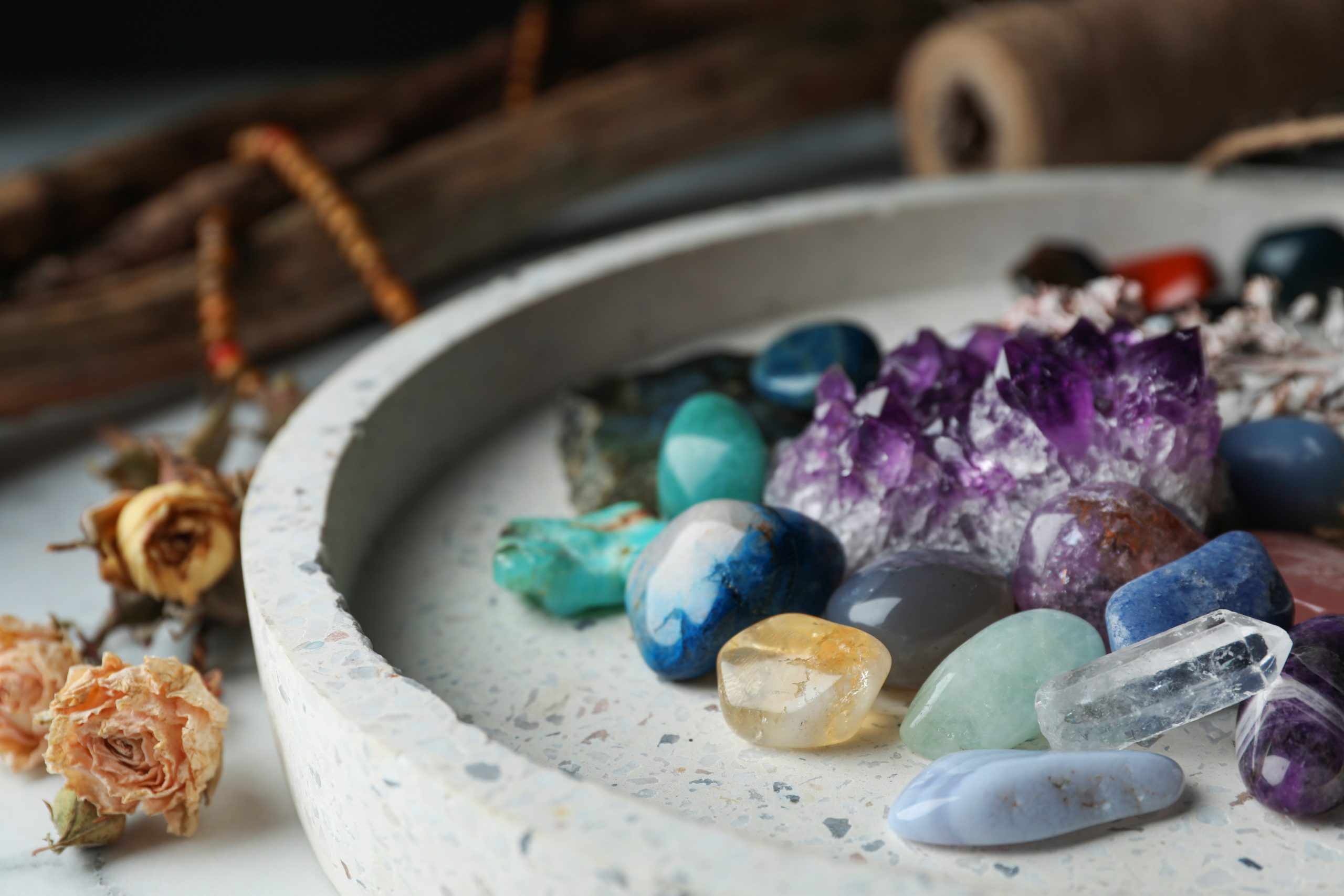 Pile of different beautiful gemstones in tray