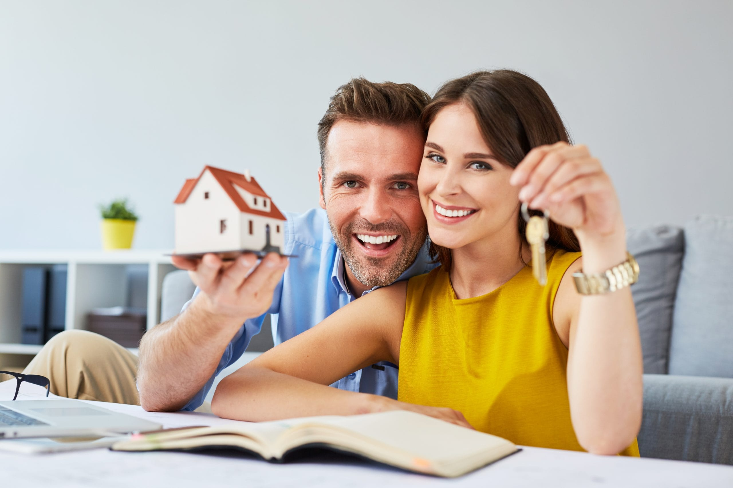 Couple with house and key